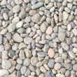Pebble heap as abstract natural background. - Stock Photo