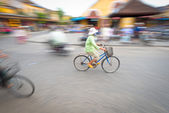 Person riding blue bike in Hoi An, Vietnam, Asia. — Stock Photo