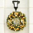 Christmas wreath on lantern on white wall. — Stock Photo #22455035