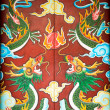 Colorful door with symmetrical dragon painting. — Stockfoto