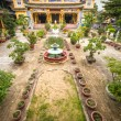 Buddhist temple and its green yard in Hoi An. - Stockfoto