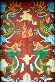 Colorful door with symmetrical dragon painting. — Stock Photo