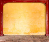 Yellow stucco wall with pattern in frame. — Stock Photo