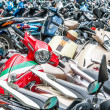 Great number of motorbikes on parking zone. - Stock Photo