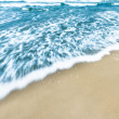 Blue ocean waves background with golden sand. — Stock Photo #22488319