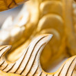 Stock Photo: Golden sculpture close-up showing dragon spine.