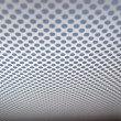 Royalty-Free Stock Photo: Grey background of perforated metal texture.