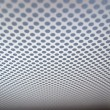 Stock Photo: Grey background of perforated metal texture.