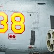 Stock Photo: Side of helicopter with missile and number 38.