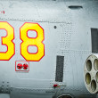 Side of helicopter with missile and number 38. - Stock Photo