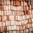 Wall of new red bricks stacked in rows. — Stock Photo #25747841