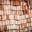 Stock Photo: Wall of new red bricks stacked in rows.