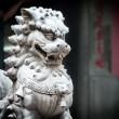 Stock Photo: Stone sculpture of dragon in buddhist temple.