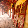 Stock Photo: Red wooden hall of Hue citadel in Vietnam, Asia.