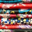 Pile of silk clothes with abstract asian design. — Stock Photo #25748025