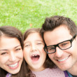 Close up portrait of happy family of three. — Stock Photo #25748027