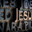 Stock Photo: Name of Jesus written on wall in cathedral.