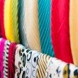 Stock Photo: Row of new multicolored scarves at shop.