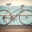Old bicycle at sea side — Stock Photo
