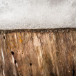 Nature background of stump with snow on it. - Stock Photo