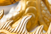 Golden sculpture close-up showing dragon spine. — Foto de Stock