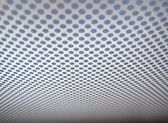 Grey background of perforated metal texture. — Stockfoto