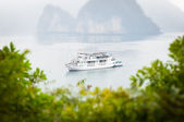 White ship crossing Halong bay in Vietnam, Asia. — Stock Photo