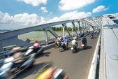On bikes on bridge of Hue, Vietnam, Asia. — Stock Photo