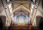 Great organ under arch in catholic church. — Stock Photo