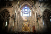 Old church interior with altar and arches. — ストック写真