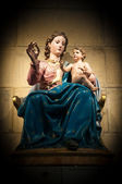 Statue of Virgin Mary with Jesus in church. — Stock Photo
