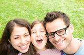 Close up portrait of happy family of three. — Stock Photo