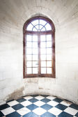 Grungy arched window inside old building. — Stock Photo
