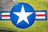 Military plane with star and stripe sign. — ストック写真