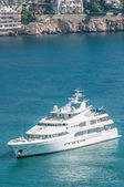 Luxurious yacht sailing on clear blue water. — Stock Photo