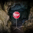 Entry to cave blocked with STOP sign — Stock Photo #45069045