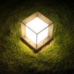Lighting cube lantern on grass — Stock Photo #45069229