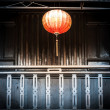 Lantern hanging in front of house — Stock Photo