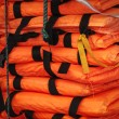 Постер, плакат: Pile of life jackets ready for shipping