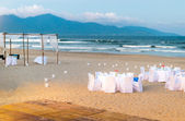 White tables served for supper on beach — Stock Photo