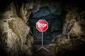 Entry to cave blocked with STOP sign — Stock Photo