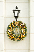 Christmas wreath on lantern — Stock Photo