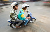Two men on bike in Hoi An — Stock Photo
