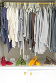 Clothes and shoes at shop — Stock Photo