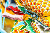 Multicolored face of vietnamese dragon — Stock Photo