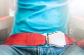 Man wearing red seat belt — Stock Photo