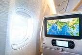 Seat monitor in passenger plane — Stock Photo