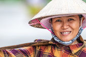 Vietnamese woman in conical hat — Stock Photo