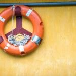 Orange old lifebuoy with rope — Stock Photo #45072585