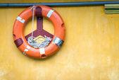 Orange old lifebuoy with rope — Stock Photo